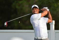 Tiger Woods drives the ball during the practice round of the 2014 Quicken Loans National at Congressional Country Club.  Mandatory Credit: Tommy Gilligan-USA TODAY Sports