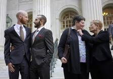 Plaintiffs Derek Kitchen (L-R) and Moudi Sbeity and Kate Call and Karen Archer talk outside the courthouse after a federal appeals court heard oral arguments on a Utah state law forbidding same sex marriage in Denver in an April 10, 2014 file photo.  REUTERS/Rick Wilking