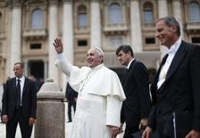 Pope Francis waves during his Wednesday general audience in Saint Peter's square at the Vatican June 25, 2014. REUTERS/Alessandro Bianchi
