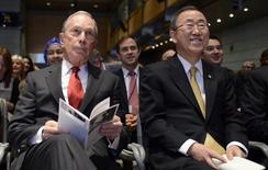 "Former New York City Mayor Michael Bloomberg (L) and UN Secretary-General Ban Ki-moon listen to opening remarks at a ""Toward Universal Health Coverage for 2030"" seminar during the IMF/World Bank 2014 Spring Meetings in Washington April 11, 2014.REUTERS/Mike Theiler"
