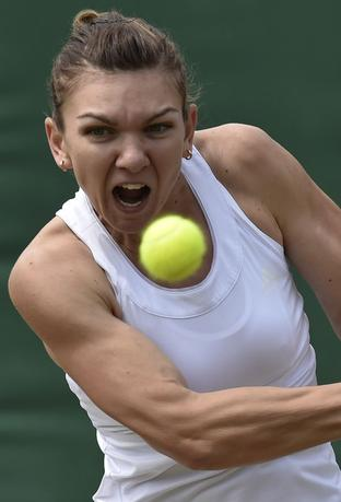 Simona Halep of Romania hits a return during her women's singles tennis match against Lesia Tsurenko of Ukraine at the Wimbledon Tennis Championships, in London June 27, 2014.  REUTERS/Toby Melville