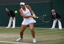 Ana Konjuh of Croatia hits a return to Caroline Wozniacki of Denmark during their women's singles tennis match at the Wimbledon Tennis Championships, in London June 27, 2014. REUTERS/Suzanne Plunkett