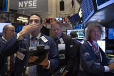 Traders work on the floor of the New York Stock Exchange June 24, 2014. REUTERS/Brendan McDermid