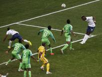 France's Paul Pogba (19) heads to score a goal against Nigeria during their 2014 World Cup round of 16 game at the Brasilia national stadium in Brasilia June 30, 2014. REUTERS/David Gray