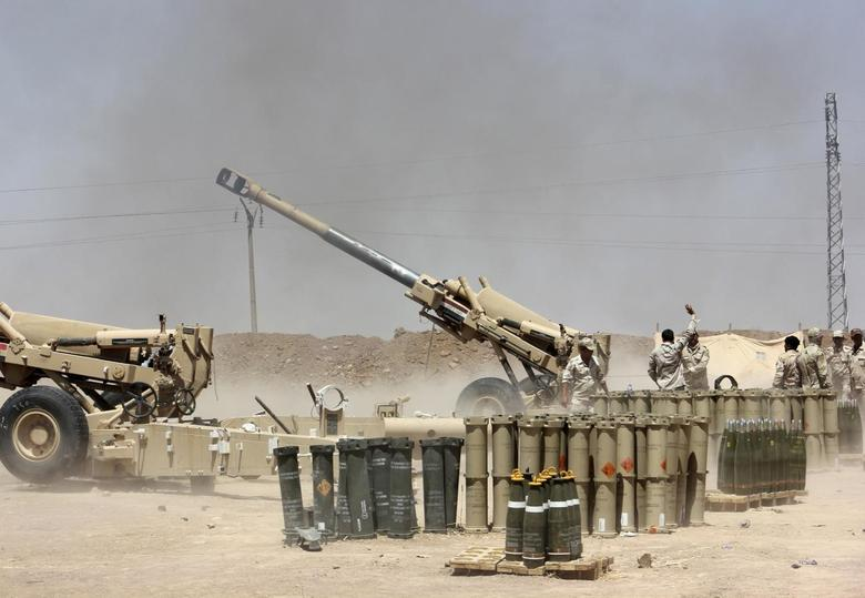 Iraqi security forces fire artillery during clashes with Sunni militant group Islamic State of Iraq and the Levant (ISIL) on the outskirts of the town of Udaim in Diyala province, June 22, 2014. REUTERS/Stringer