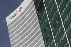 The HSBC building is pictured in Mexico City, December 11, 2012. HSBC Holdings Plc has agreed to pay $1.92 billion (1.2 billion pounds) to settle a multi-year U.S. criminal probe into money-laundering lapses at the British lender, the largest penalty ever paid by a bank. HSBC admitted to a breakdown of controls and apologised in a statement on Tuesday announcing it had reached a deferred-prosecution agreement with the U.S. Department of Justice, as was first reported by Reuters last week. REUTERS/Edgard Garrido (MEXICO - Tags: BUSINESS CRIME LAW SOCIETY) - RTR3BGQZ