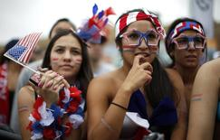 USA fans react during the 2014 World Cup Group G soccer match between Germany and the U.S. at a viewing party in Hermosa Beach, California June 26, 2014. REUTERS/Lucy Nicholson