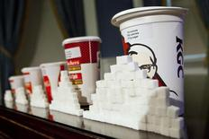 A 64-ounce drink is displayed alongside other soft drink cup sizes at a news conference at City Hall in New York, May 31, 2012.  REUTERS/Andrew Burton