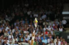 Roger Federer of Switzerland serves during his men's singles semi-final tennis match against Milos Raonic of Canada at the Wimbledon Tennis Championships, in London July 4, 2014.          REUTERS/Stefan Wermuth