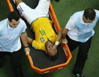 Brazil's Neymar grimaces as he is carried off the pitch after being injured during their 2014 World Cup quarter-finals against Colombia at the Castelao arena in Fortaleza July 4, 2014.       REUTERS/Fabrizio Bensch (BRAZIL  - Tags: SOCCER SPORT WORLD CUP TPX IMAGES OF THE DAY)