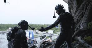 """Actors Andy Serkis (R) and Toby Kebbell are seen in their roles as apes Caesar and Koba from the upcoming film """"Dawn of the Planet of the Apes"""" in this publicity photo released to Reuters June 30, 2014.  REUTERS/Weta/20th Century Fox/Handout via Reuters"""