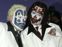 Members of the Insane Clown Posse pose as they arrive at the 2003 Billboard Music Awards at the MGM Grand Garden Arena in Las Vegas, Nevada, December 10, 2003. REUTERS/Fred Prouser  FSP/WS - RTR8L5R