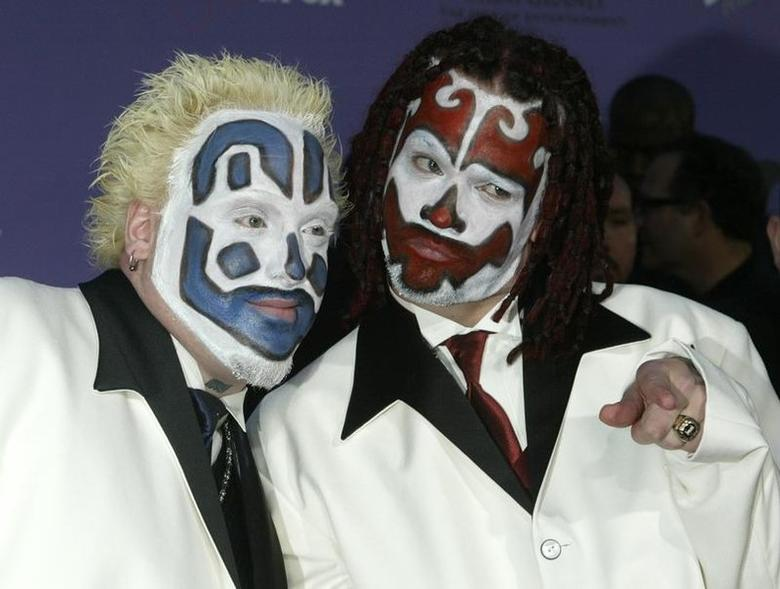 Members of the Insane Clown Posse pose as they arrive at the 2003Billboard Music Awards at the MGM Grand Garden Arena in Las Vegas,Nevada, December 10, 2003. REUTERS/Fred ProuserFSP/WS - RTR8L5R