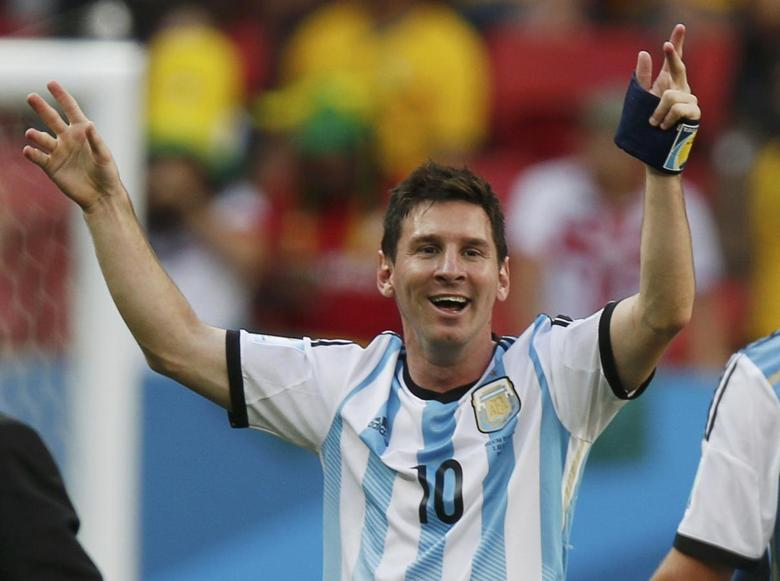 Argentina's Lionel Messi celebrates his team's win over Belgium after their 2014 World Cup quarter-finals at the Brasilia national stadium in Brasilia July 5, 2014.  REUTERS/Ueslei Marcelino