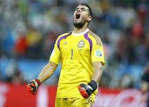 Argentina's goalkeeper Sergio Romero reacts after saving a goal attempt from Ron Vlaar of the Netherlands during a penalty shoot-out during their 2014 World Cup semi-finals at the Corinthians arena in Sao Paulo July 9, 2014. REUTERS/Dominic Ebenbichler