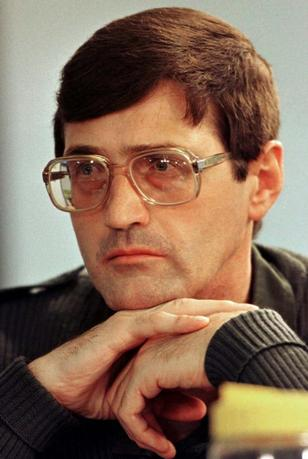 Convicted apartheid policeman Eugene de Kock listens to questions put to him by lawyers at the special public hearing of South Africa's Truth and Reconciliation Commission in Johannesburg in this January 29, 1998 file photograph.  REUTERS/Juda Ngwenya/Files