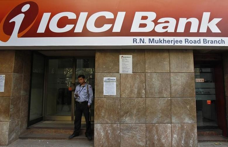 A private security personnel stands guard outside an ICICI Bank branch in Kolkata January 29, 2014. REUTERS/Rupak De Chowdhuri/Files