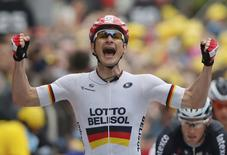 Lotto-Belisol team rider Andre Greipel of Germany celebrates as he crosses the finish line to win the 194 km sixth stage of the Tour de France cycling race from Arras to Reims July 10, 2014.            REUTERS/Jean-Paul Pelissier