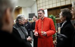 New Cardinal Rainer Maria Woelki of Germany receives guests in the Paul VI hall at the Vatican February 18, 2012. REUTERS/Tony Gentile
