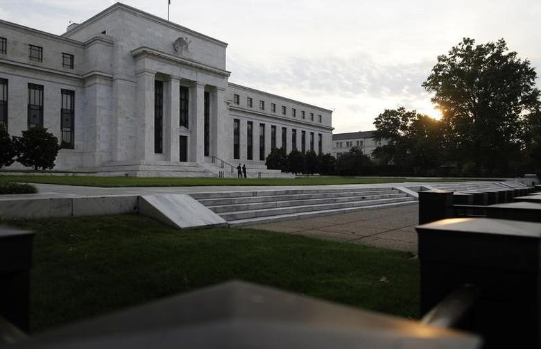 The sun rises to the east of the U.S. Federal Reserve building in Washington, July 31, 2013. REUTERS/Jonathan Ernst