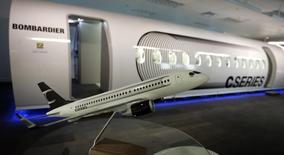 A scale model of a CS100 Bombardier airplane is displayed beside a mock-up of the future CSeries Bombardier aircraft at the Bombardier Inc. Montreal offices September 14, 2009.  The planes are scheduled for first deliveries in 2013.  REUTERS/Christinne Muschi