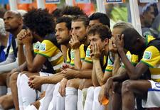 Brazil's players watch from the bench. REUTERS/Dominic Ebenbichler