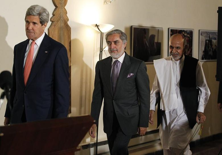 Afghanistan's presidential candidates Abdullah Abdullah (C) and Ashraf Ghani (R) arrive at a news conference with U.S. Secretary of State John Kerry (L) at the United Nations Compound in Kabul, July 12, 2014.  REUTERS/Jim Bourg