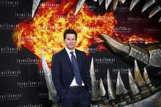 """Cast member Mark Wahlberg poses for pictures before the European premiere of the movie """"Transformers: Age of Extinction"""" in Berlin June 29, 2014. REUTERS/Thomas Peter"""