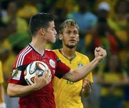 Colombiano James Rodríguez comemora gol contra o Brasil.   REUTERS/Yves Herman