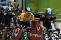 Britain's Bradley Wiggins races during stage eight of the Tour of Britain in Whitehall, central London September 22, 2013. REUTERS/Olivia Harris