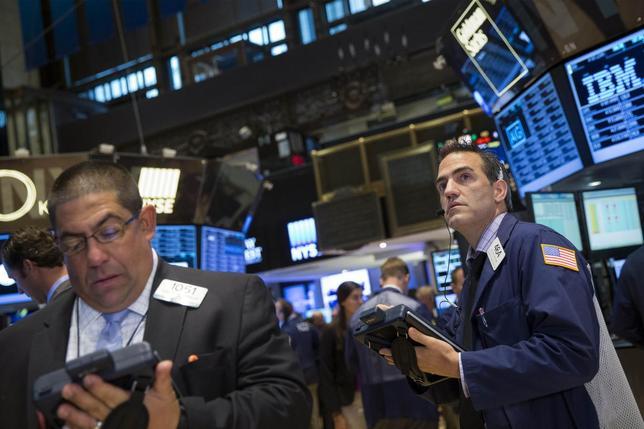 Traders work on the floor of the New York Stock Exchange July 9, 2014. REUTERS/Brendan McDermid