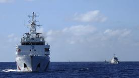Chinese coastguard ships give chase to Vietnamese coastguard vessels (not pictured) after they came within 10 nautical miles of the Haiyang Shiyou 981, known in Vietnam as HD-981, oil rig in the South China Sea, July 15, 2014.   REUTERS/Martin Petty