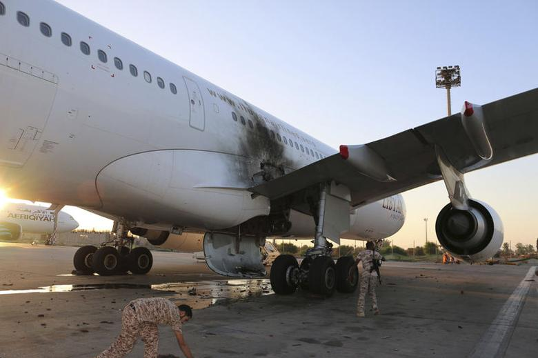 A damaged aircraft is pictured after a shelling at Tripoli International Airport July 15, 2014.REUTERS/Hani Amara