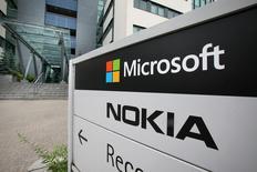 Microsoft va supprimer jusqu'à 18.000 postes, soit environ 14% de ses effectifs, essentiellement pour prendre en compte le rachat de Nokia en avril. /Photo prise le 16 juillet 2014/REUTERS/Markku Ruottinen/Lehtikuva