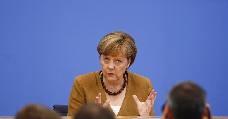 German Chancellor Angela Merkel attends a news conference in Berlin, July 18, 2014.      REUTERS/Thomas Peter