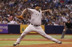 New York Yankees starting pitcher CC Sabathia (52) throws a pitch during the first inning against the Tampa Bay Rays at Tropicana Field. Apr 17, 2014; St. Petersburg, FL, USA; Kim Klement-USA TODAY Sports