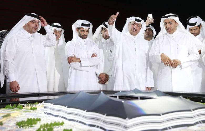 Secretary-General Hassan Al-Thawadi (3rd L) of Qatar's Supreme Committee for Delivery and Legacy, the nation's 2022 World Cup organising committee, speaks during a news conference to announce the start of work on the Al-Khor Stadium in Al-Khor June 21, 2014. REUTERS/Mohammed Dabbous