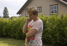 Laila Gustavsen, a former lawmaker whose daughter Marte Oedegaarden was a survivor of the July 22, 2011 Utoeya island massacre, poses for a photo at her home in Kongsberg July 10, 2014.   REUTERS/Gwladys Fouche