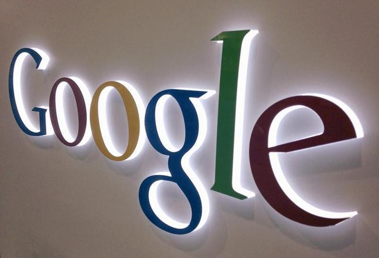 A Google sign is seen at a Best Buy electronics store in this photo illustration in Encinitas, California April 11, 2013. REUTERS/Mike Blake/Files