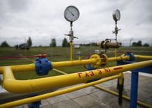 Газовая компрессорная станция близ села Ковалевка в Полтавской области Украины 27 июня 2014 года. Европа существенно сократила поставки газа испытывающей дефицит энергоресурсов Украине, которая видит в этом противодействие российского экспортера Газпрома, до июня обеспечивавшего около половины потребностей украинской экономики в топливе. REUTERS/Gleb Garanich