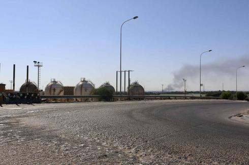 Rival Libyan militias clash in Tripoli, Benghazi
