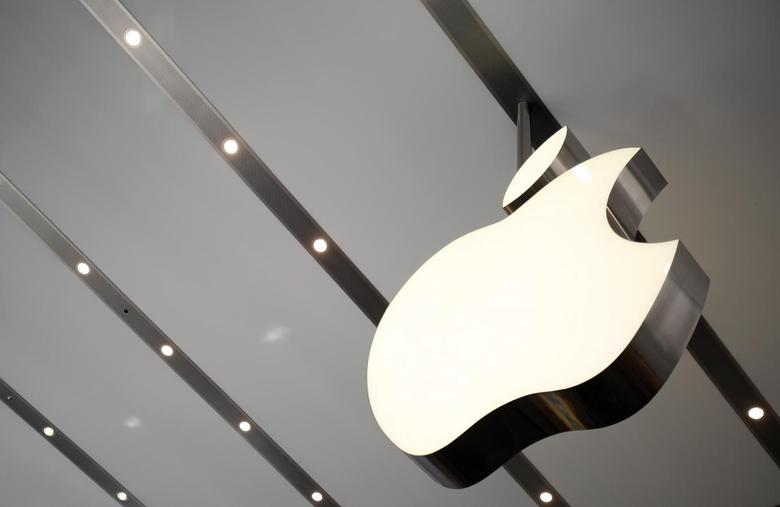 The Apple logo is pictured inside the newly opened Omotesando Apple store at a shopping district in Tokyo June 26, 2014. REUTERS/Yuya Shino/Files
