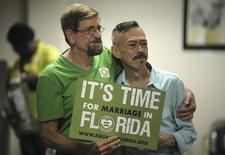 Patrick Gibbons (L) and Aaron Vargas of Oakland Park participate in the Decision Day Celebration Rally at the Pride Center, in Wilton Manors, Florida, July 17, 2014.  REUTERS/Michael Laughlin/South Florida Sun-Sentinel
