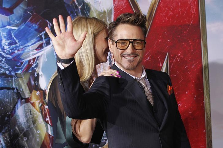Cast member Robert Downey Jr. waves next to co-star Gwyneth Paltrow at the premiere of ''Iron Man 3'' at El Capitan theatre in Hollywood, California April 24, 2013. REUTERS/Mario Anzuoni/Files