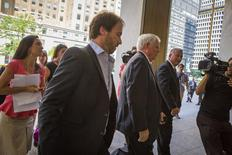 Argentina's Economy Ministry's Legal and Technical Secretary Federico Thea (2nd L) arrives at the office of a court-appointed mediator for a meeting on Argentina's dispute with holdout investors over its sovereign debt, in New York July 11, 2014.  REUTERS/Brendan McDermid