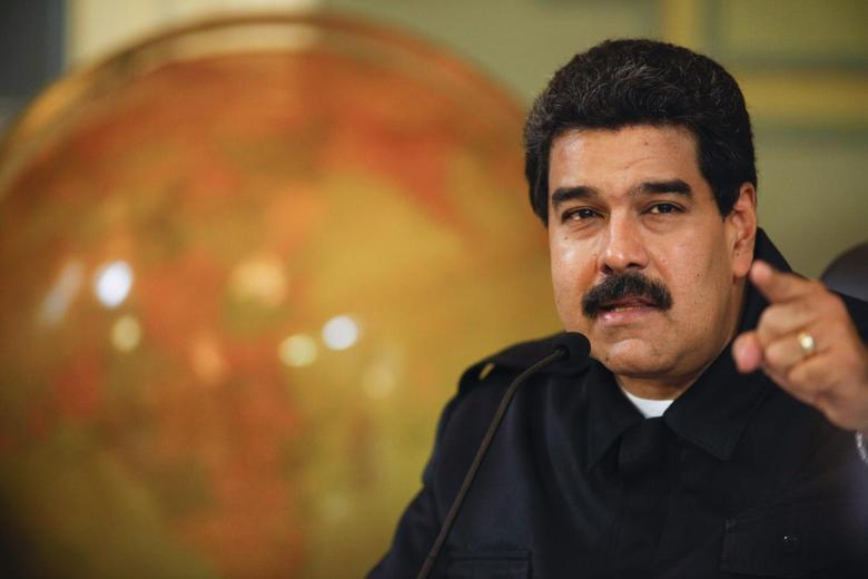 Venezuela's President Nicolas Maduro speaks during a news conference at Miraflores Palace in Caracas, in this handout photo provided by Miraflores Palace July 23, 2014. REUTERS/Miraflores Palace/Handout via Reuters