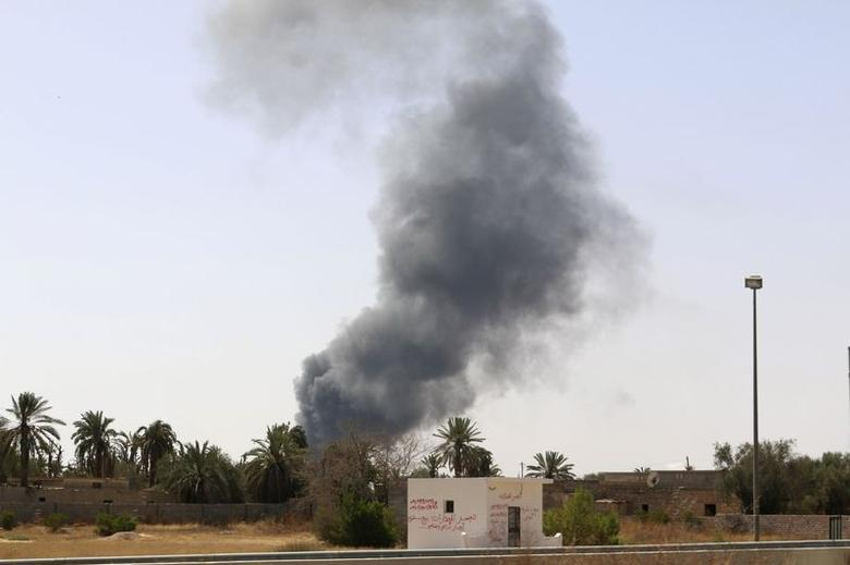 Smoke rises over the Airport Road area after heavy fighting between rival militias broke out near the airport in Tripoli July 25, 2014.  REUTERS/Hani Amara