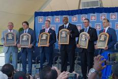 Jul 27, 2014; Cooperstown, NY, USA; (From Left to Right) Hall of Fame Inductees Bobby Cox and Tony La Russa and Tom Glavine and Frank Thomas and Greg Maddux and Joe Torre pose with their Hall of Fame plaques during the class of 2014 national baseball Hall of Fame induction ceremony at National Baseball Hall of Fame. Mandatory Credit: Gregory J. Fisher-USA TODAY Sports