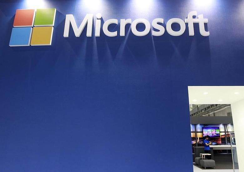 A employee stands in the Microsoft booth during the 2014 Computex exhibition at the TWTC Nangang exhibition hall in Taipei June 3, 2014.  REUTERS/Pichi Chuang