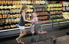 A woman and child shop at a Walmart in Bentonville, Arkansas June 5, 2014.      REUTERS/Rick Wilking